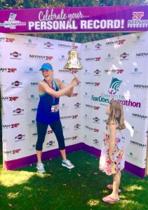 Emily ringing the bell at the Marathon.