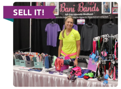 Lady selling gear at expo center.