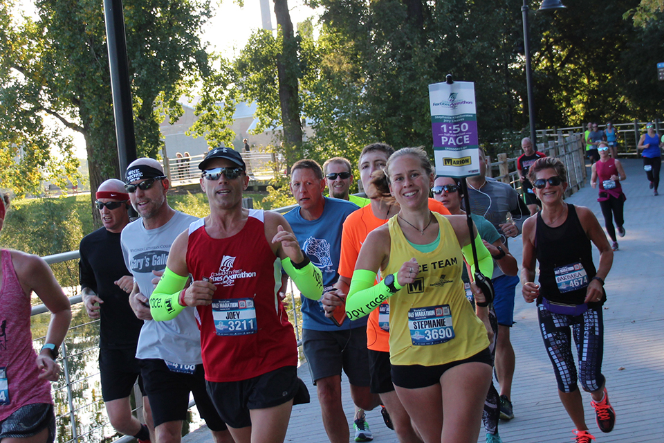 Runners cross the Trestle Trail in Fox Crossing during the Community First Fox Cities Marathon.