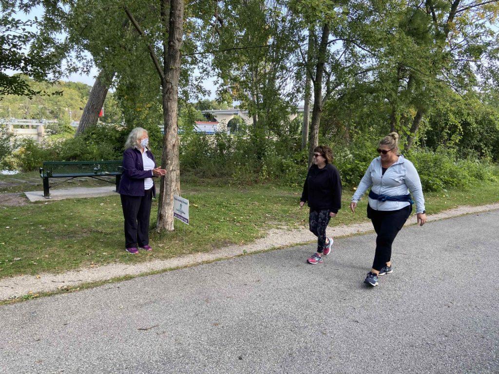 Pop-up Cheer Volunteers surprise runners, walkers and bikers along the Newberry Trail in Appleton.