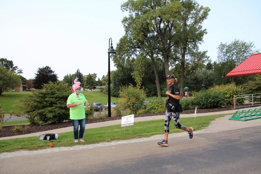 Pop-up Cheer Volunteers encourage runners and walker at Fritse Park in Fox Crossing.